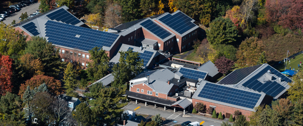 A nonprofit organization with financed solar panels on their roof)