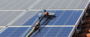 Machines performing maintenance on residential solar panels