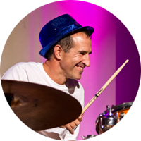 IGS employee drumming