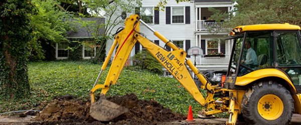 Contractor working on exterior utility lines)