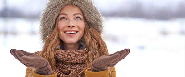 Bundled up woman outside in the snow)