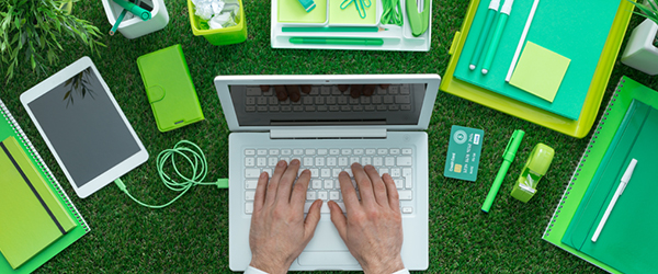 Laptop, tablet, notebooks and desk material outside on grass)