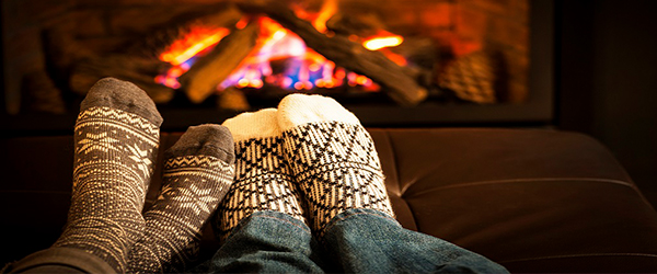 Socked feet warming by a fire)