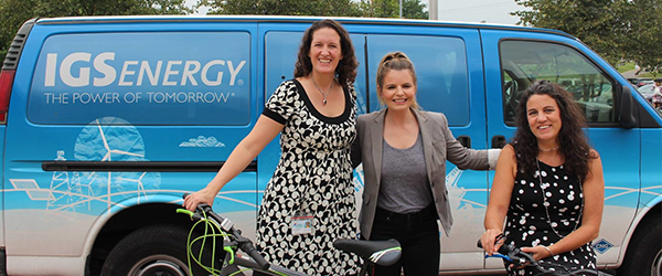 Employees with bikes in front of IGS Energy Van