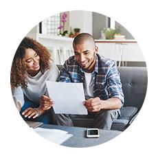 Circular image of couple looking at bills